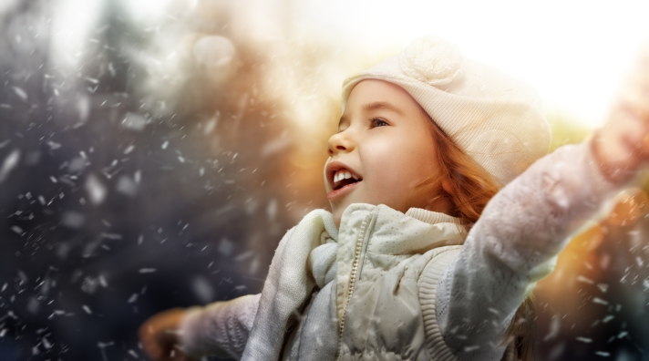 a beautiful child enjoying winter