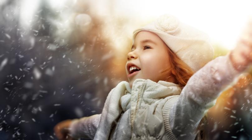 a beautiful child enjoying winter
